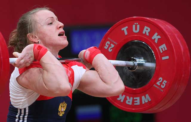 epa03920963 Tima Turieva of Russia in action in the clean and jerk discipline of the women's 63 kg category at the World Weightlifting Championships in Wroclaw, Poland, 23 October 2013.  EPA/Radek Pietruszka  POLAND OUT